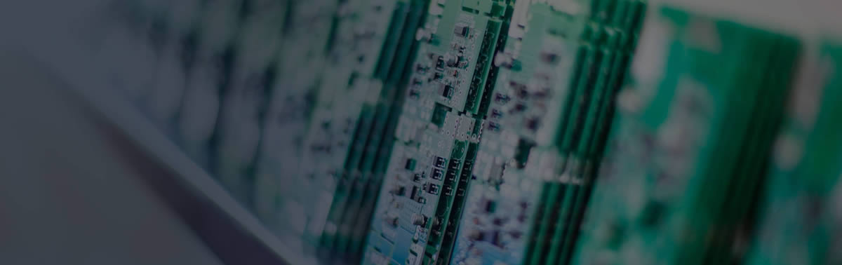 A close up of printed circuit boards stacked in a row.